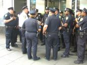 English: New York City Police officers being debriefed by their lieutenant (in the white shirt) in Times Square, May 29, 2010. Photo by Luigi Novi. This photo may be used and modified, for any purpose, only if the photographer is visibly credited in each