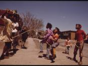 BLACK CHILDREN PLAY OUTSIDE THE IDA B. WELLS HOMES, ONE OF CHICAGO'S OLDEST HOUSING PROJECTS. THERE ARE 1,652... - NARA - 556160