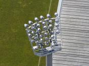 A soccer field from above focusing on the floodlight