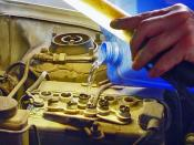 English: Filling a car battery with distilled water