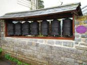 English: Tibetan prayer wheels All religions, cults, beliefs and alternative cultures are catered for in Glastonbury. The place would welcome everyone from the Dalai Lama to Bilbo Baggins.