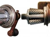 English: A wall-mounted pencil sharpener with its casing removed to reveal the mechanism.