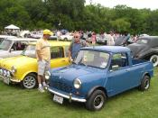 A Mini pickup truck - photographed at the All British Car Day at White Rock Lake in Dallas, Texas in April 2006. The wheels, wheel-arch