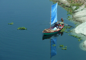 English: Blue sailed boat in Bangladesh.