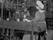 Female worker in an H. J. Heinz can factory crimping can ends onto cans using machinery. From the materials for the Alaska-Yukon-Pacific Exposition of 1909, held in Seattle.