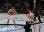 English: Picture of fighters Shane Carwin and Junior Dos Santos facing off at UFC 131 in Vancouver, Canada.