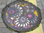A painted manhole cover in Matsumoto, Japan. Photo taken by me in July, 2006.
