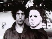 Nick Castle holds up the original Michael Myers mask, the character Castle is most famous for portraying.