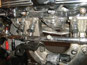 Jeep 2.5 Liter, four-cylinder engine, chromed. This picture of the display engine shows part of the fuel injection system (with MPFI). The fuel rail is connected to the injectors that are mounted just above the intake manifold. This engine was developed b