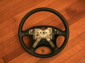 English: Steering wheel from a 1990 Geo Storm GSi, with the air bag module removed.