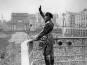 Il Duce: Italian Prime Minister Benito Mussolini rendering the Roman salute to his audience.