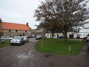 English: The Marketplace Lindisfarne market place by the Manor House, Crown & Anchor and ruins of the Priory