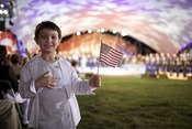 A young patriot salutes heroes at the 2009 National Memorial Day Concert on the West Lawn of the United States Capitol. See more at Army.mil