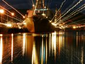 English: 061220-N-4965F-006 Pearl Harbor, Hawaii - Holiday lights shine from Arleigh-Burke class guided-missile destroyer USS Russell (DDG 59) as she sits moored pier side Naval Station Pearl Harbor. Ships currently moored in Pearl Harbor will participate