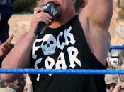 Stone Cold Steve Austin, one of the World Wrestling Entertainment (WWE) superstars performing for the Coalition troops at Camp Victory, Baghdad International Airport (BIAP), Iraq (IRQ) during Operation IRAQI FREEDOM.