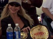 Women's World Wrestling Federation Champion Debra takes a moment out of her autographing session to pose for the cameras. WWF wrestlers were guest of the Coast Guard at the annual airshow held on Andrews AFB.
