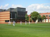 The Cripps Centre (left) and main buildings (right) at Caulfield Campus, with Alf Mills Oval in the foreground