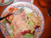 Thousand Island Dressing on a plate of salad. Taken by Flickr user JND90745 at Pancho's restaurant, Manhattan Beach, California, USA.