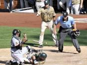 English: Luis Rodriguez out at home 8