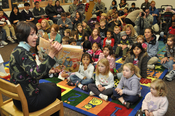 English: Joanne Sharp, wife of Gen. Walter Sharp, United States Forces Korea commanding geneeral, visited the U.S. Army's Yongsan Garrison Library on Nov. 21, 2009 to read to military family members as part of a Thanksgiving Story Hour.
