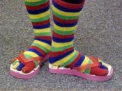 Rainbow striped toe socks worn with thong sandals