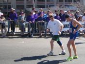 English: A man helps a friend along at the 2005 Boston Marathon, near mile 25 on the MBTA overpass. Location: Boston, Massachusetts, USA