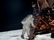 Apollo 11 astronaut Edwin E. Aldrin, Jr. leaves the Lunar Module Eagle to take his first steps as the second man on the moon.
