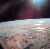 English: This view of Earth showing clouds over water was photographed from the Apollo 11 spacecraft following translunar injection. While astronauts Neil A. Armstrong, commander, and Edwin E. Aldrin Jr., lunar module pilot, descended in the Lunar Module