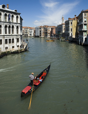 English: Taken from the Rialto Bridge, a lone gondolier takes his gondola up the Grand Canal.