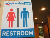 English: Restroom signs at Wikimania 2011