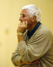 ELMENDORF AIR FORCE, Alaska -- Coach Bobby Knight, Texas Tech University basketball, watches his players practice at the fitness center here Nov. 21. Coach Knight spoke with Airmen and Soldiers before his team began practicing for the Carrs/Safeway Great