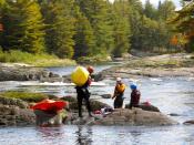 English: Whitewater kayakers Chewonki Semester School having a break (Maine, USA)