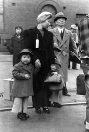 Los Angeles, California. The evacuation of Japanese-Americans from West Coast areas under U.S. Army war emergency order. Japanese-American family waiting for train to take them to Manzanar War Relocation Center, Owens Valley.