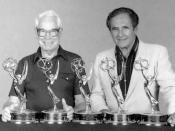 Hanna-Barbera founders William Hanna (left) and Joseph Barbera pose with several of the Emmy awards the Hanna-Barbera studio has won.