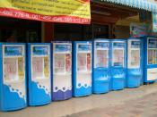English: A row of drinking water vending machines in Pattaya, Thailand. A liter of water sold (in a customer's own bottle) for 1 baht.