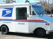 A small United States Postal Service truck seen in Carson City, Nevada. The USPS often uses these smaller vehicles in suburban areas.