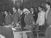English: The Palestinian National Council assembly in Cairo. Yasser Arafat (in keffiyeh), behind him is Yousef an-Najjar, and Khaled al-Hassan.