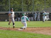 English: A Batter runs to first base attempting to beat the throw from the third baseman who fielded the ball.