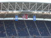 Picture of banners for retired Seahawks Numbers as they hang over the East (visitors) sideline in Qwest Field, Seattle Washgington. 12 FAN, 80 Largent, Steve.