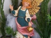 Angel appearing to shepherds for Nativity scene in Florida. Figure is painted by crèche artist Bill Egan.