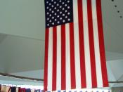 Taken in Philadelphia, Pennsylvania, in September 2003. A large U.S. flag hangs in the center of the National Constitution Center, surrounded by the various state flags.