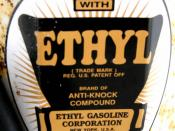 English: Sign on an antique gasoline pump, advertising gasoline additive (tetraethyl lead) by the Ethyl Corporation. Photo taken at the highway rest stop on I-94 westbound, east of Bismarck, North Dakota, USA.