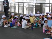 Elementary School Students on a field trip, waiting for a train. Kagoshima,JAPAN.