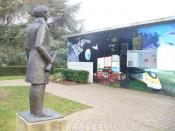 English: The Fuel Cell Visitor attraction in Woking Park. Woking became Britain's first borough to be powered by a fuel cell providing electric power and water - this was in 2003. The statue is of Sir William Grove, he developed the idea of fuel cells in