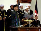 Chief Justice Shinwani from the Supreme Court of Afghanistan (right) administers the Oath of Office for the Presidential Inauguration to Afghanistan President Hamid Karzai at the Presidential Palace in Kabul, Afghanistan, Dec 7, 2004. Defense Dept. photo