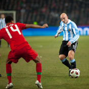 Esteban Cambiasso during the friendly match Argentina − Portugal at Geneva, Switzerland. Rolando (Portugal) on the left.
