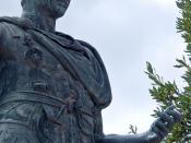 English: A bronze statue of Gaius Julius Caesar beside the Via Foro Imperiali in front of the Forum Julia in the heart of Rome, Italy. Although assassinated on the Ides of March in 44 BCE, people still honor him with wreaths and bouquets of flowers over 2