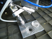 English: An example of a 5-Axis waterjet cutting head used to cut complex 3-Dimensional parts on a CNC waterjet cutting machine.