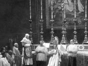 English: Copyright expired photo of Pope Pius X (standing on the left) on December 18, 1907 consecrating Giacomo della Chiesa (sitting in front of the altar with mitre and crosier; later Pope Benedict XV) in the Vatican.