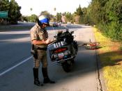 English: A motorcycle patrol officer on the San Tomas Expressway near Benton Avenue in , USA.